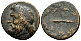 Kingdom of Epeiros, Pyrrhos. 297-272 BC. Æ19, 5.05 g. Laureate head of Zeus Dodonaeus left / thunderbolt; above and below: A Π; all within oak wreath....
