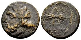 Kingdom of Epeiros, Pyrrhos. 297-272 BC. Æ18, 5.29 g. Laureate head of Zeus Dodonaeus left / thunderbolt; above and below: A Π; all within oak wreath....