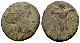 Epeiros, Ambrakia. . Ca. 238-168 BC. Æs, 7.13 gr. Head of Apollo with laurelwreath / AM-BR Zeus striding right with thunderbolt and Aegis. SNG Cop. 31...