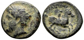 Kingdom of Macedon, Philip II. Uncertain mint in Macedon, 315-295 BC. Æ18, 5.86 g. Head of Apollo left / ΦIΛIΠΠOY youth on horseback right; below: sym...