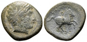 Kingdom of Macedon, Philip II. Uncertain mint in Macedon, 315-295 BC. Æ19, 6.91 g. Head of Apollo right; behind: A / ΦIΛIΠΠOY youth on horseback right...