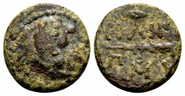 Kingdom of Macedon, Philip II. Uncertain mint in Macedon, 315-295 BC. Æ10, 1.24 g. Head of young Herakles / club; above and below: ΦIΛIΠΠOY; above: sp...