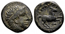 Kingdom of Macedon, Alexander III. Uncertain mint in Macedon, 336-323 BC. Æ15, 4.15 g.  Head of Apollo right / ΑΛEΞΑΝΔΡΟΥ horse rearing right; below: ...