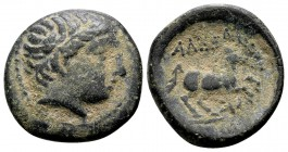 Kingdom of Macedon, Alexander III. Uncertain mint in Macedon, 336-323 BC. Æ17, 4.22 g.  Head of Apollo right / ΑΛEΞΑΝΔΡΟΥ horse rearing right; below: ...