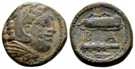 Kingdom of Macedon, Alexander III. Uncertain mint in Macedon, 325-310 BC. Æ17, 6.31 g.  Head of young Herakles right, wearing lion skin / B Α bow, qui...