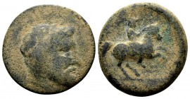 Thessaly, Krannon. Ca. 350-300 BC. Æ dichalkon, 4.66 g. Laureate head of Poseidon (or Zeus) right / [KPAΩNΩ] horseman rearing right. BCD Thessaly II 1...
