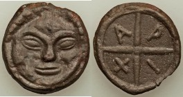 BLACK SEA REGION. Olbia. Ca. 437-410 BC. Cast AE (29mm, 9.89 gm, 5h). VF. Facing gorgoneion with triangular face and protruding tongue / Wheel with fo...