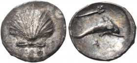 CALABRIA. Tarentum. Circa 325-280 BC. Hemilitron (Silver, 9 mm, 0.42 g). Scallop shell. Rev. Dolphin swimming to right; above, kerykeion to right; bel...