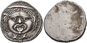 Populonia. 20 units after 211, AR 8.37 g. Gorgoneion; below, X:X. Rev. Blank. Vecchi, Rasna 55 (this obverse die). Vecchi 58.127 (this coin). SNG Ashm...
