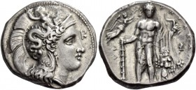 Lucania, Heraclea. Nomos circa 330-320, AR 7.90 g. Head of Athena r., wearing helmet decorated with Scylla hurling stone and palmette on neck-guard; i...