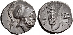 Metapontum. Nomos circa 290-280, AR 7.85 g. Bearded head of Leucippus r., wearing crested Corinthian helmet with bowl decorated with wreath; behind ne...