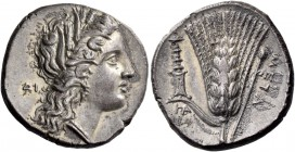 Metapontum. Nomos circa 290-280, AR 7.62 g. Head of Demeter r., wearing barley wreath, triple-pendant earring and pearl necklace; in l. field, ΔI. Rev...