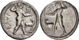 Bruttium, Caulonia. Nomos circa 525-500, AR 7.87 g. KAVΛ Apollo, diademed, walking r., holding laurel branch in upraised r. hand and small running dai...
