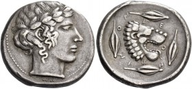 Leontini. Tetradrachm circa 440-435, AR 17.02 g. Laureate head of Apollo r. Rev. LE – O – N – T – IN – ON Lion's head r., with jaws open and tongue pr...