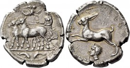 Messana. Tetradrachm circa 412-408, AR 16.91 g. Biga of mules driven l. by nymph Messana; above, Nike flying r. to crown the nymph. In exergue, two do...