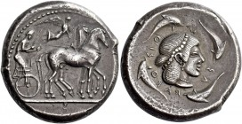 Syracuse. Tetradrachm circa 475-470, AR 17.39 g. Slow quadriga driven r. by charioteer holding reins and kentron; above, Nike flying r., crowning hors...