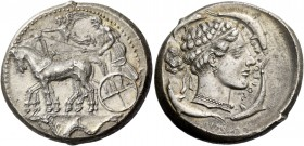 Syracuse. Tetradrachm circa 440-430, AR 17.37 g. Slow quadriga driven l. by charioteer holding kentron and reins; above, Nike flying l. to crown the h...