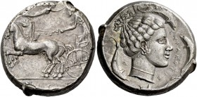 Syracuse. Tetradrachm circa 440-430, AR 17.15 g. Prancing quadriga driven l. by charioteer, holding kentron and reins; above, Nike flying r. to crown ...