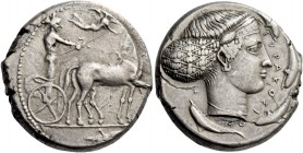 Syracuse. Tetradrachm circa 420-415, AR 17.27 g. Slow quadriga driven r. by charioteer, holding reins and kentron; above, Nike flying r. to crown hors...