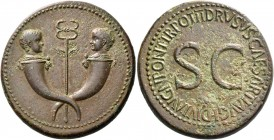 In the name of Drusus, son of Tiberius. Sestertius 22-23, Æ 28.33 g. Confronted heads of two little boys on crossed cornucopiae with caduceus between....