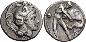 Lucania, Heraclea. Nomos circa 390-340, AR 6.57 g. Head of Athena r., wearing Attic helmet decorated with Scylla, holding a rudder on l. shoulder. Rev...