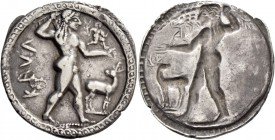 Caulonia. Nomos circa 525-500, AR 8.23 g. Apollo, diademed, walking r., holding laurel branch in upraised r. hand and small running daimon who holds l...