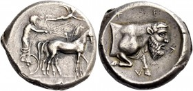 Gela. Tetradrachm circa 420-415, AR 17.15 g. Slow quadriga driven r. by charioteer, holding kentron and reins; above, Nike flying r. to crown the hors...