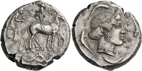 Syracuse. Tetradrachm circa 460-450, AR 16.97 g. Slow quadriga driven r. by charioteer, holding kentron and reins; above, Nike flying r. to crown hors...