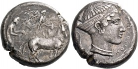 Syracuse. Tetradrachm circa 430, AR 17.22 g. Slow quadriga driven r. by charioteer, holding kentron and reins; above, Nike flying r. to crown horses. ...