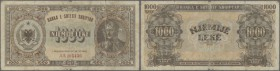 Albania: 1000 Leke 1947 P. 23, strong used with 3 strong vertical fold, several other folds and creases in paper, stain, borders a worn at upper and l...