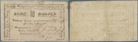 Armenia: City government Kars 10 Rubles ND(1919), P.NL in well worn condition with several folds and stains, tiny hole at lower margin. Condition: F-