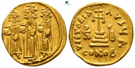 Heraclius, with Heraclius Constantine and Heraclonas AD 610-641. Dated IY 12=AD 638/9. Constantinople. 1st officina. Solidus AV
