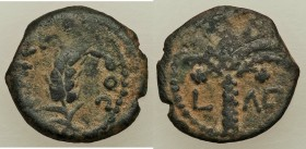 JUDAEA. Roman Procurators. Coponius (AD 6-9) AE prutah (16mm, 1.97 gm, 1h). VF. Jerusalem, Regnal Year 36 of Augustus (AD 5/6). KAICA-POC, grain ear /...