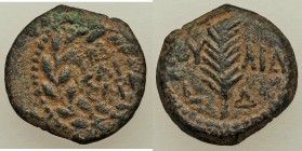 JUDAEA. Roman Procurators. Valerius Gratus (AD 15-26). AE prutah (15mm, 2.05 gm, 12h). XF. Jerusalem, dated Regnal Year 4 of Tiberius (AD 17/8). TIB /...