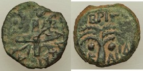 JUDAEA. Roman Procurators. Antonius Felix (AD 52-59). AE prutah (17mm, 2.80 gm, 12h). VF. Jerusalem, Regnal Year 14 of Claudius, Nero and Britannicus ...