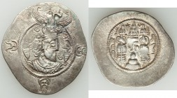 TOKHARISTAN. Yabghus of Bactria. Ca. AD 6th- 7th century. AR drachm (31mm, 4.11 gm, 8h). VF. Sasanian-type bust right, wearing crown topped by buffalo...