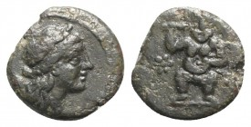 Islands of Spain, Ebusus, late 2nd-early 1st centuries BC. Æ (11.5mm, 1.46g, 6h). Laureate head of Apollo r. R/ Bes standing facing; rosette to l. CNH...