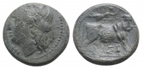 Southern Campania, Neapolis, c. 270-250 BC. Æ (18mm, 5.10g, 6h). Laureate head of Apollo l. R/ Man-headed bull standing r., being crowned by Nike who ...