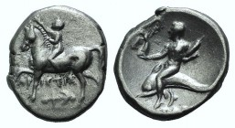 Southern Apulia, Tarentum, c. 272-240 BC. AR Nomos (20mm, 6.30g, 5h). Youth on horseback l., placing wreath on horse's head. R/ Taras on dolphin, hold...