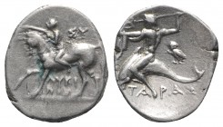Southern Apulia, Tarentum, c. 272-240 BC. AR Nomos (20mm, 6.55g, 6h). Nude youth crowning horse he rides l. R/ Phalanthos, preparing to throw trident ...