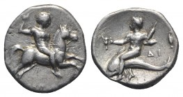 Southern Apulia, Tarentum, c. 272-240 BC. AR Nomos (19mm, 6.27g, 3h). Horseman r., holding javelin. R/ Dolphin rider l., holding distaff and kantharos...