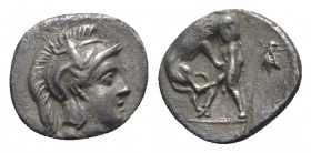 Southern Apulia, Tarentum, c. 280-228 BC. AR Diobol (10mm, 1.06g, 6h). Helmeted head of Athena l., wearing crested helmet decorated with Skylla. R/ He...