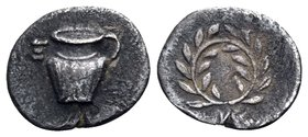 CALABRIA. Tarentum. Circa 450-380 BC. Hemiobol (Silver, 8 mm, 0.29 g, 12 h). Skyphos with handle to right; to left, Ξ. Rev. Wreath. HN III 867. Vlasto...