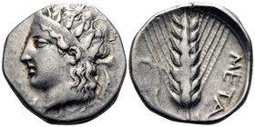 LUCANIA. Metapontum. Circa 400-340 BC. Didrachm or nomos (Silver, 21 mm, 7.86 g, 11 h). Youthful head of Dionysos to left, wearing a diadem adorned wi...