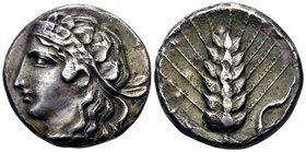 LUCANIA. Metapontum. Circa 400-340 BC. Didrachm or nomos (Silver, plated, 19 mm, 5.78 g, 12 h), c. 400-380. Head of Nike to left, wearing a diadem orn...