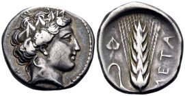 LUCANIA. Metapontum. Circa 400-340 BC. Didrachm or nomos (Silver, 21.5 mm, 7.50 g, 2 h), signed by Poly.... Head of Dionysos to right, wearing ivy wre...