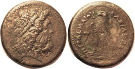 Ptolemy III, Æ35, Zeus head r/Eagle l, Chi-Rho monogram betw legs, AVF, centered, brown patina, slight to moderate graininess. Zeus head well detailed...