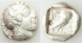 ATTICA. Athens. Ca. 465-455 BC. AR tetradrachm (23mm, 17.06 gm, 5h). VF, bankers punch. Head of Athena right, wearing crested Attic helmet ornamented ...