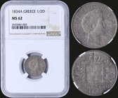 "GREECE: 1/2 Drachma (1834 A) (type I) in silver with ""ΟΘΩΝ ΒΑΣΙΛΕΥΣ ΤΗΣ ΕΛΛΑΔΟΣ"". Inside slab by NGC ""MS 62"". (Hellas 95)."