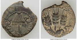 JUDAEA. Herodians. Agrippa I (AD 37-44). AE prutah (17mm, 11h). VF, altered surfaces. Dated Regnal Year 6 (AD 41/2). BACIΛEΩC AΓPIΠA, umbrella-like ca...